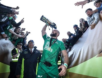 John Muldoon kept his newly acquired trophy in the safest of places last night