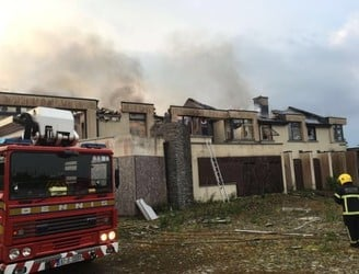 Fire brigade brings major fire at 10-bedroom house in Dublin under control