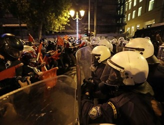 Obama calls for Greek debt relief as protesters clash with police in Athens