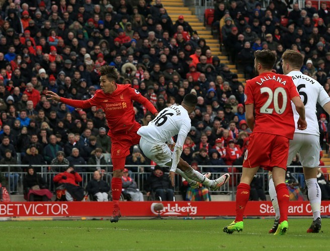 Roberto Firmino scoring one of his two goals against Swansea today.
